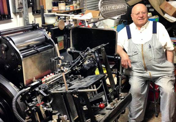 HCA- Heritage Happenings- Fall-2014 Ambrosi Printers shop Dad sitting