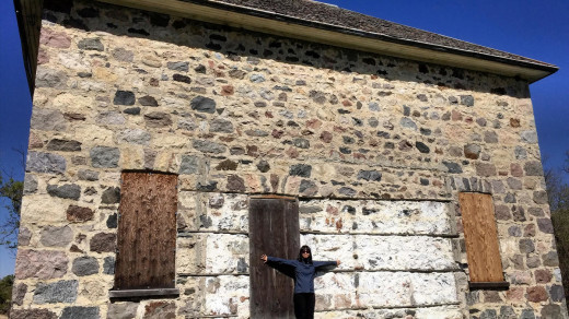 2015-05-18_1027 EDIT 1200px   J takes a photo by the walls of the stone house that has stood for decades.